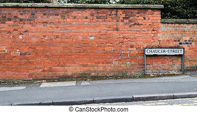 Street Sign Against Brick Wall