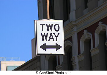Street sign for Two Way traffic symbolized by a white sign...