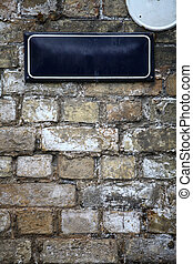Street sign on a brick wall