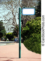 Street Sign on a green pole