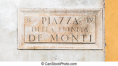 street sign on the wall in Rome, Italy