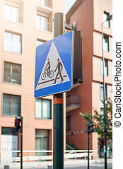 Street sign pedestrian and cyclist crossing.