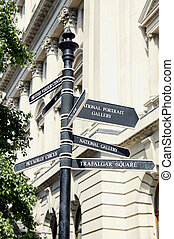 Street signpost giving directions to National Gallery, Trafalgar Square and Piccadilly Circus in London England