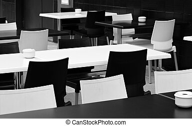 Street small cafe with bw tables and chairs.