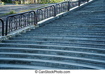 Street stairs with steel handrail, no people.