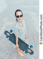 Street style girl with longboard. - Street style girl in...