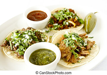 Street Style Tacos - A beef, carnitas, and chicken taco with...