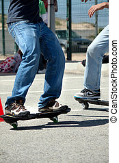 Street surfer boys - View of two young street-surfing adepts...