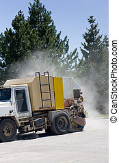Street sweeper with dust trail