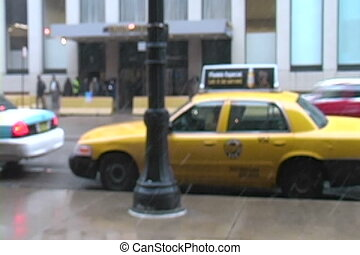 Street Tilt Up - Camera tilts up from a taxi on the sidewalk...