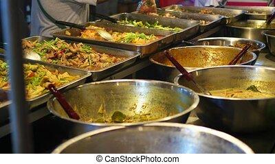 Street trade. Traditional Asian meat satay street food...