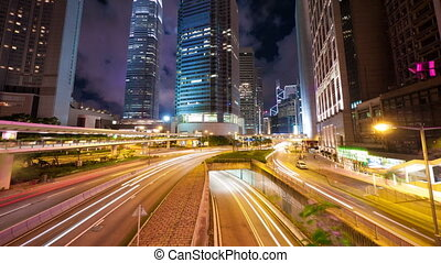 Street traffic in Hong Kong at night, timelapse in motion