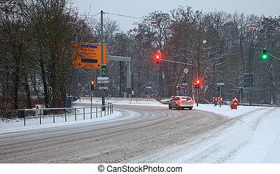 Street traffic in snowstorm
