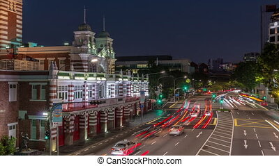 Street traffic near the fire station of Singapore day to night transition aerial timelapse. The Central Fire Station is the oldest existing fire station in Singapore on Hill street