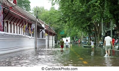 "flood - ""Street under flood in Bangkok Thailand. Life..."