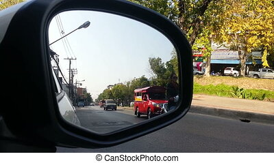 street view from car side mirror