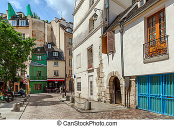 Street view in Paris, France. - View on narrow street among...