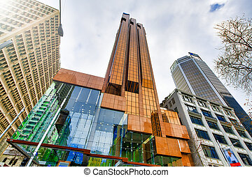 Street view of Auckland buildings in downtown on a cloudy day, New Zealand