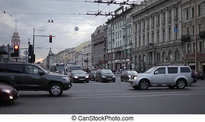 Street with cars in St. Petersburg Shops cars and houses on...