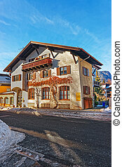 Street with Chalet and Alps at winter Garmisch Partenkirchen