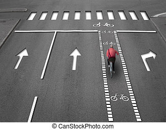 Cyclist in red shirt in street with lanes, arrows and a cycling path with 3D effect