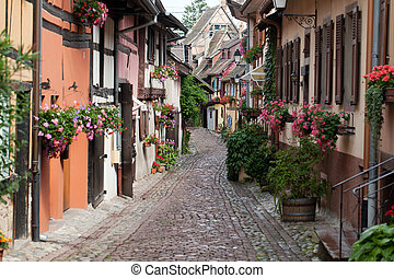 Street with half-timbered medieval houses in Eguisheim...