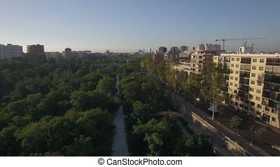 Street with park and traffic in Valencia, aerial view