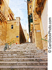 Street with staircase at old city center of Valletta