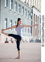 Street yoga: Revolved Hand to Big Toe Pose - Yoga in the...