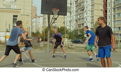 Streetball forward setting a screen on defender - Teenage...