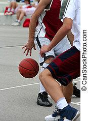 Streetball match - Boys playing streetball on schoolyard