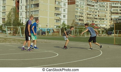 Streetball player dribbling the ball on court - Offensive...