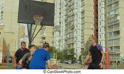 Streetball player missing shot in the paint on court