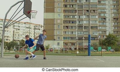Streetball player scoring field goal on court