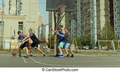 Streetball player scoring point after jump shot