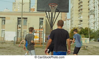 Streetball player scoring points after rebound - Streetball...