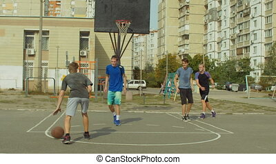 Streetball player taking a set shot on court