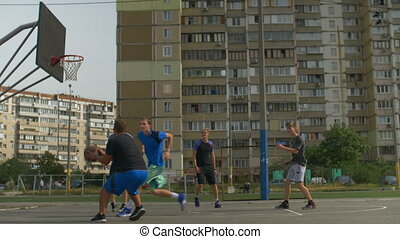 Streetball player taking a shot during basketball game