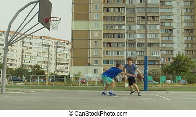 Streetball player taking jump shot on basketball court