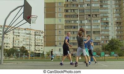 Streetball player taking layup shot on basketball court