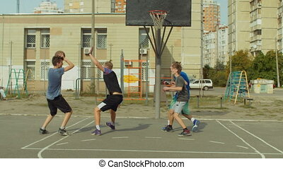 Streetball players in action on basketball court
