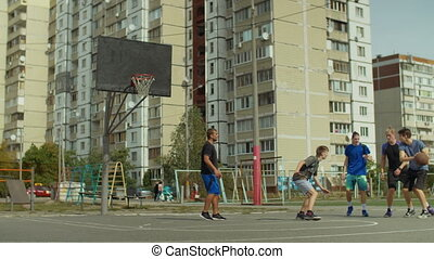 Streetball players playing basketball on court