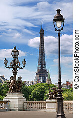 Street lanterns on the bridge Alexandre III and the Eiffel tower in Paris, France.