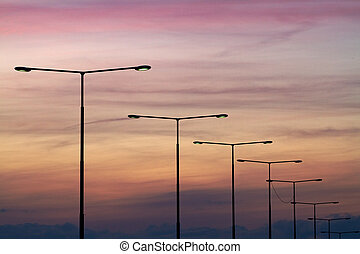 Streetlights. -  Streetlights at sunset.