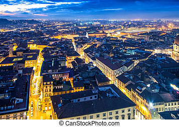 Streets and rooftops of Florence. City night lights after sunset.