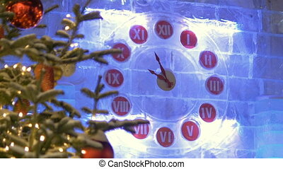 Streets are decorated for Christmas. The clock shows the time until the new year.