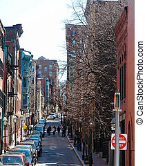 Looking up one of the many brownstone lined streets in boston's beacon hill district,