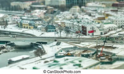 Streets of Minsk, Belarus winter. Car and people move quickly. Titelapse tilt shift