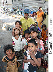 A poor family / people of beggars, living on the street side in India.