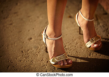 Streetwalker - natural warm light, selective focus on the...